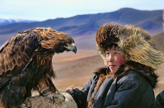 Mongolian Dukha tribe - boy with eagle
